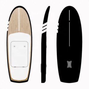 dotshio_tabla_surf_efoil_foil_electrica_bateria_surfer_orilla_mar